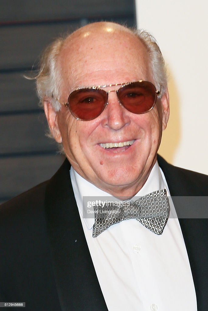Singer-songwriter Jimmy Buffett arrives at the 2016 Vanity Fair Oscar Party Hosted by Graydon Carter at the Wallis Annenberg Center for the Performing Arts on February 28, 2016 in Beverly Hills, California.