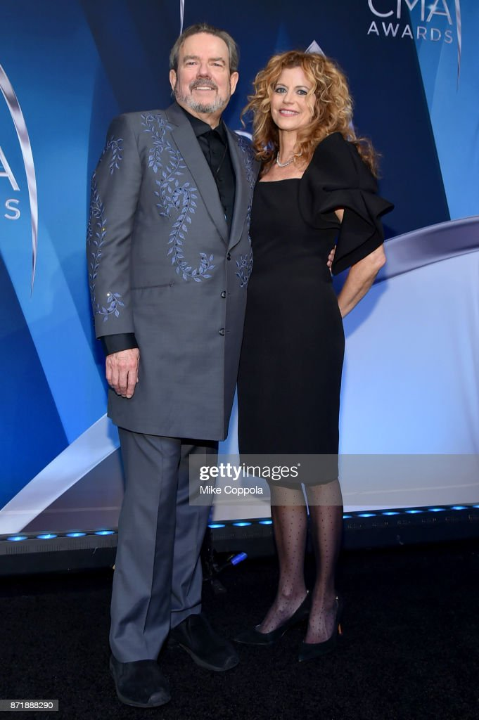 Singer-songwriter Jimmy Webb (L) and Laura Savini pose in the press room the 51st annual CMA Awards at the Bridgestone Arena on November 8, 2017 in Nashville, Tennessee.