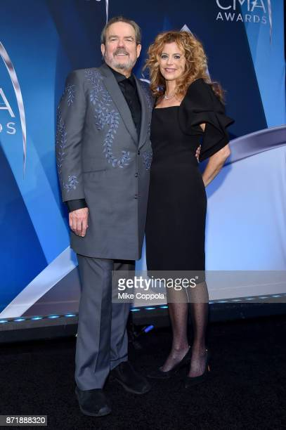 Singersongwriter Jimmy Webb and Laura Savini pose in the press room the 51st annual CMA Awards at the Bridgestone Arena on November 8 2017 in...