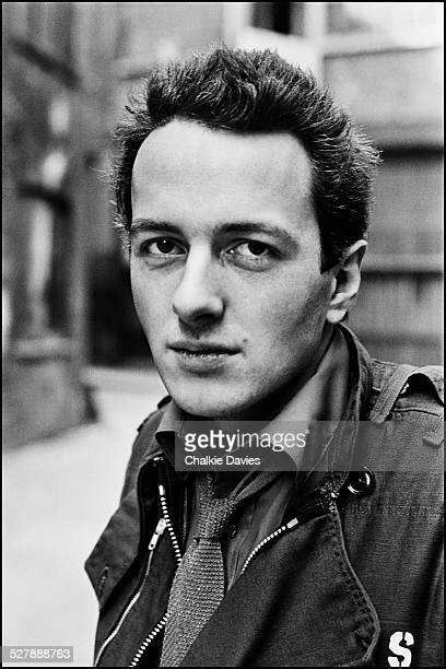 Singer-songwriter Joe Strummer of British punk group The Clash, in an alleyway in Central London, April 1977.