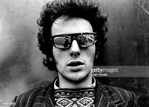 Singer-songwriter Joe Strummer of English pub rock group The 101ers, at his squat at 42 Orsett Terrace, London, W2, 1976. Strummer joined The Clash...