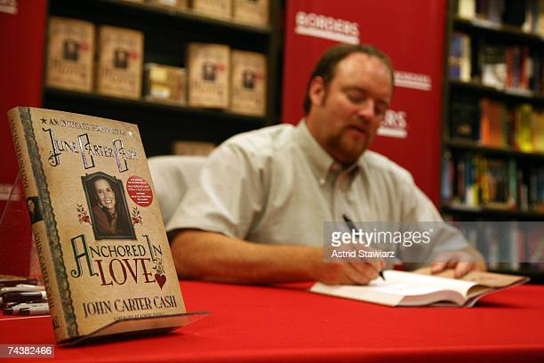 Singersongwriter John Carter Cash signs copies of his book Anchored In Love at Borders Books in the Time Warner Center June 2 2007 in New York City