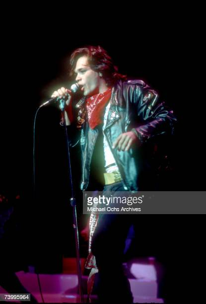 Singer/songwriter John Cougar Mellencamp performs onstage wearing a Creem Magazine t-shirt in 1982.