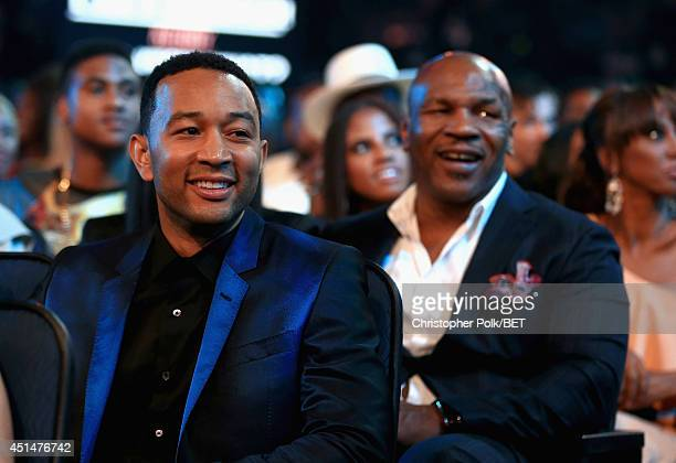 Singer/songwriter John Legend and former boxer Mike Tyson attend the BET AWARDS '14 at Nokia Theatre LA LIVE on June 29 2014 in Los Angeles California
