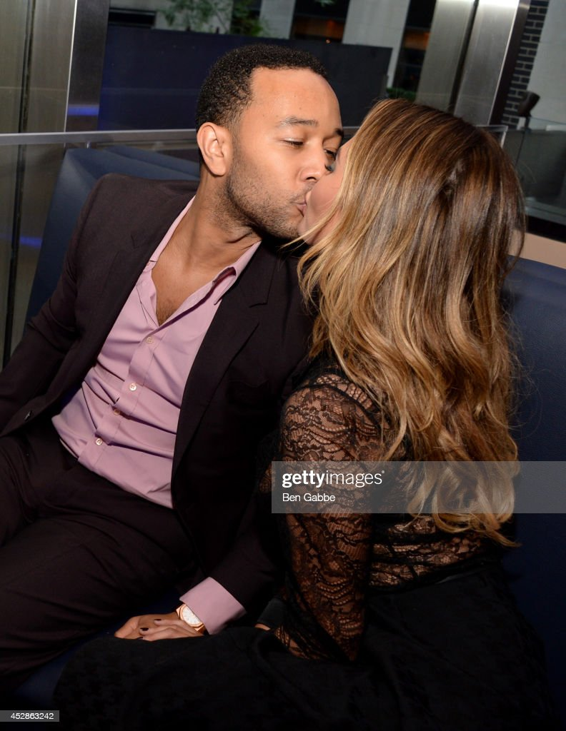 Singer-songwriter John Legend (L) and model Chrissy Teigen attend DuJour Magazine and NYY Steak celebrating Chrissy Teigen with FENDI timepieces and Moet Ice on July 28, 2014 in New York City.