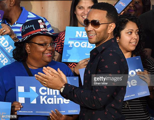Singer/songwriter John Legend greets supporters after his wife model and television personality Chrissy Teigen spoke at a campaign event with US Sen...