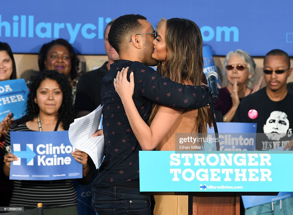 Singer/songwriter John Legend (L) hugs his wife, model and television personality Chrissy Teigen after she spoke at a campaign event with U.S. Sen. Elizabeth Warren (D-MA) at The Springs Preserve on October 4, 2016 in Las Vegas, Nevada. Warren and Teigen are campaigning for Democratic presidential nominee Hillary Clinton and former Nevada Attorney General and U.S. Senate candidate Catherine Cortez Masto.