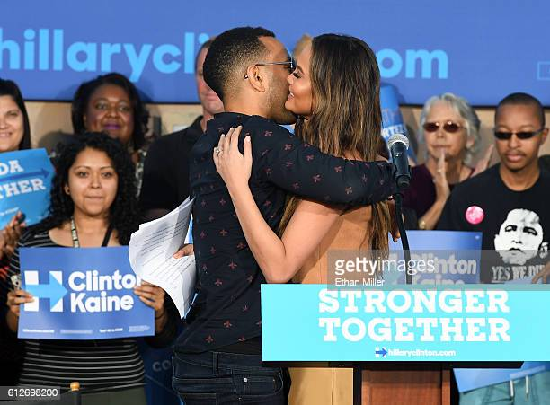 Singer/songwriter John Legend hugs his wife model and television personality Chrissy Teigen after she spoke at a campaign event with US Sen Elizabeth...