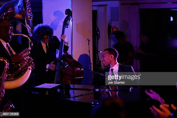 Singer/songwriter John Legend performs with Preservation Hall Jazz Band at the Nielsen PreGRAMMY Party at Mondrian Los Angeles on January 25 2014 in...