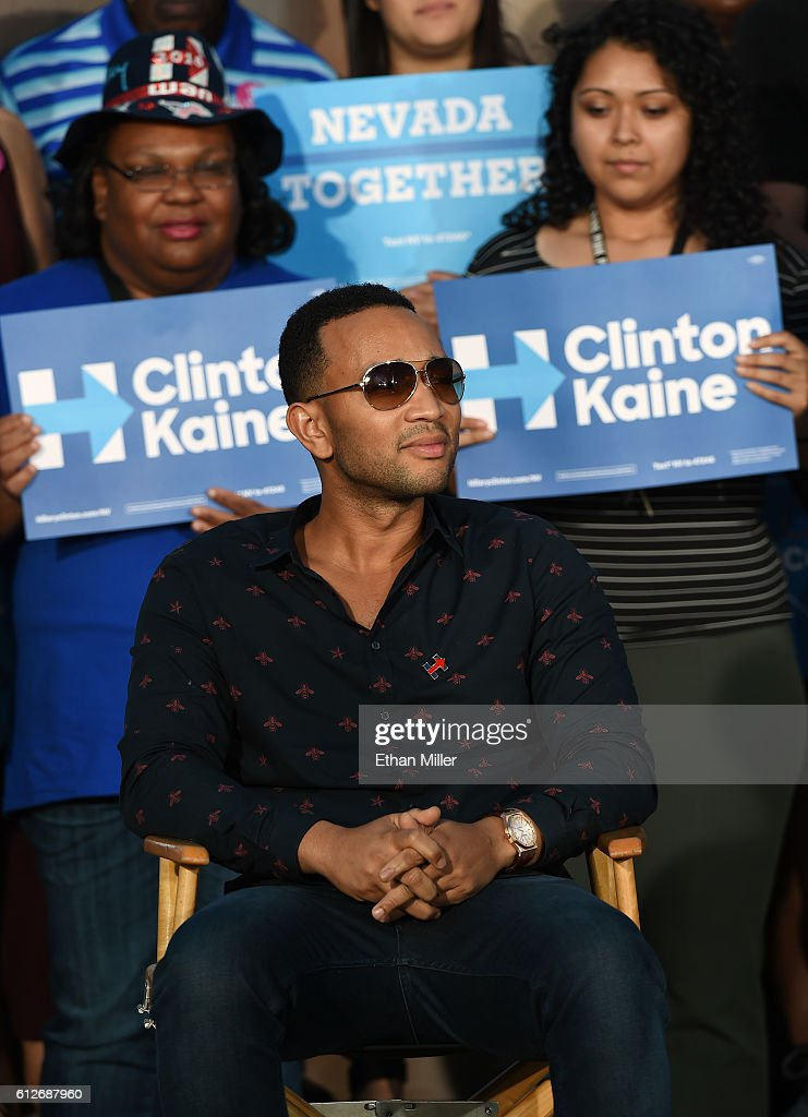 Singer/songwriter John Legend sits onstage to listen to his wife, model and television personality Chrissy Teigen (not pictured), speak at a campaign event with U.S. Sen. Elizabeth Warren (D-MA) at The Springs Preserve on October 4, 2016 in Las Vegas, Nevada. Warren and Teigen are campaigning for Democratic presidential nominee Hillary Clinton and former Nevada Attorney General and U.S. Senate candidate Catherine Cortez Masto.