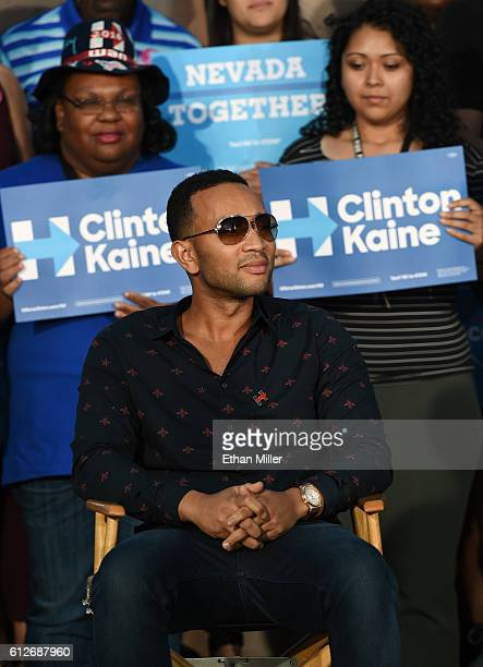 Singer/songwriter John Legend sits onstage to listen to his wife model and television personality Chrissy Teigen speak at a campaign event with US...