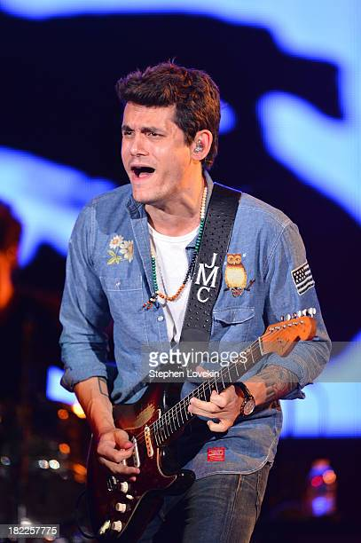 Singersongwriter John Mayer performs at the 2013 Global Citizen Festival in Central Park to end extreme poverty on September 28 2013 in New York City...