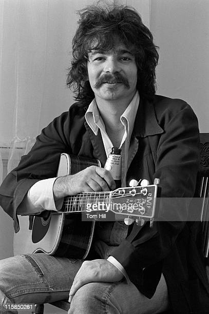 Singer-songwriter John Prine hangs out with his guitar in an apartment on Briarcliff Road on November 12, 1975 in Atlanta, Georgia.