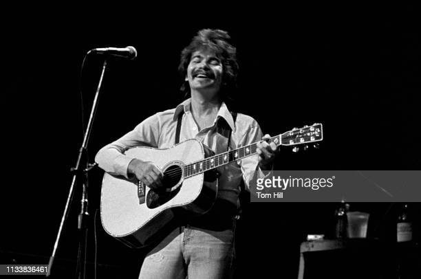 Singer-songwriter John Prine performs at Atlanta Symphony Halll on April 23, 1975 in Atlanta, Georgia.