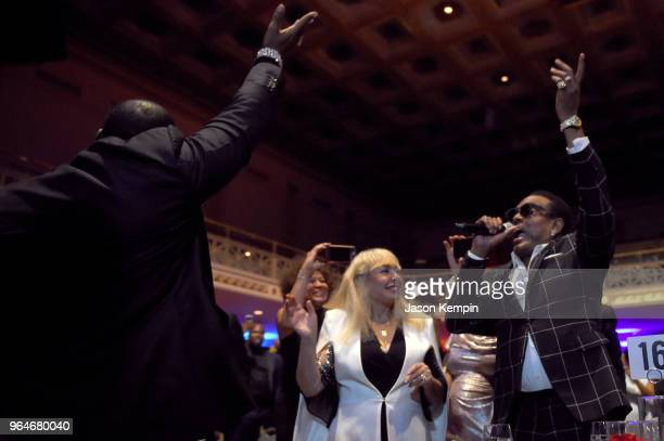 Singersongwriter Johnny Gill performs in the crowd next to Mahin Wilson and musician Charlie Wilson during NMAAM Celebration of Legends Galaon May 31...