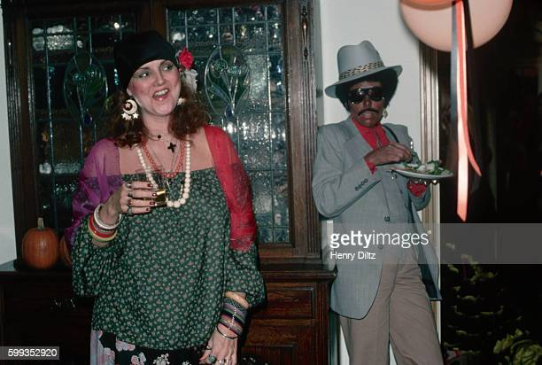 Singersongwriter Joni Mitchell attends a Halloween party as a stereotypical black pimp