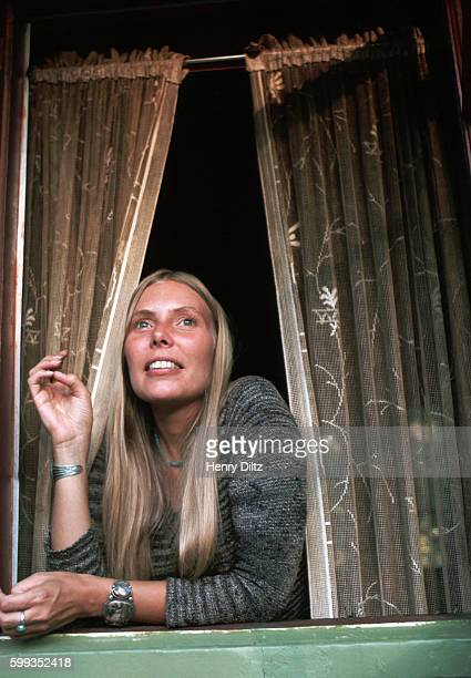 Singersongwriter Joni Mitchell looks out a window of her Laurel Canyon home