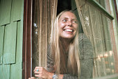 Singersongwriter joni mitchell looks out a window of her laurel home picture id599352548?s=170x170