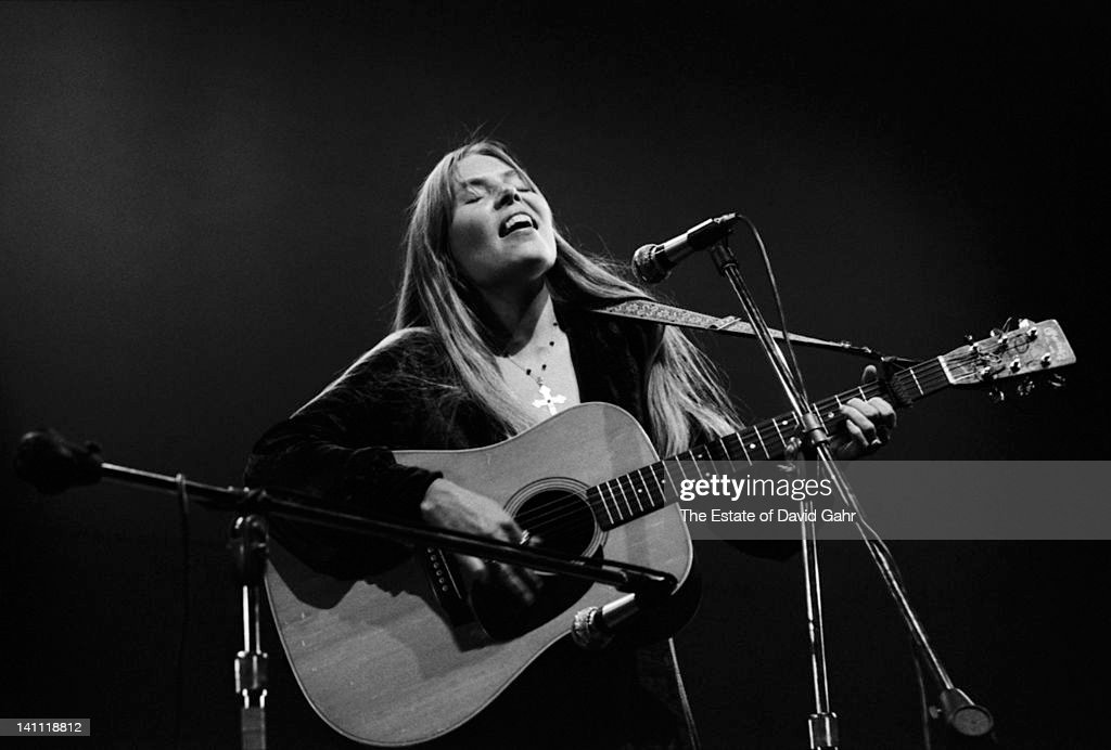 Singer/songwriter Joni Mitchell performs at the Newport Folk Festival in July 1969 in Newport, Rhode Island.