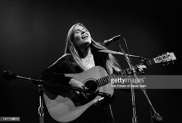 Singer/songwriter Joni Mitchell performs at the Newport Folk Festival in July 1969 in Newport Rhode Island