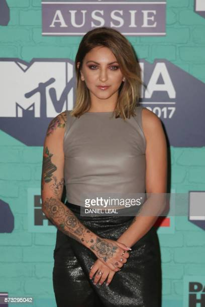 US singersongwriter Julia Michaels poses on the red carpet arriving to attend the 2017 MTV Europe Music Awards at Wembley Arena in London on November...