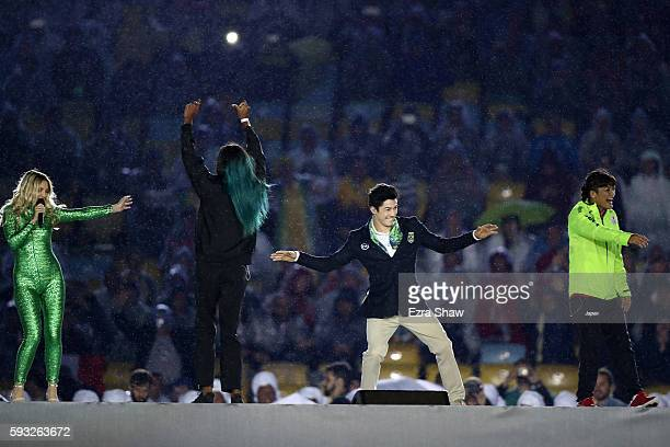 Singersongwriter Julia Michaels Shaunae Miller of Bahamas Arthur Nory Mariano of Brazil Kaori Icho of Japan dance on stage during the Closing...