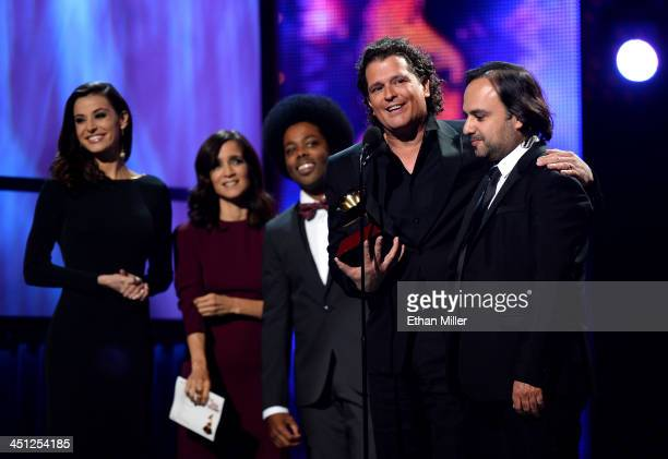 Singer/songwriter Julieta Venegas and recording artist Alex Cuba present the Song of the Year Award for 'for 'Volví a Nacer' to singer Carlos Vives...