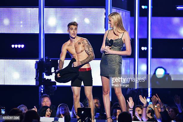Singersongwriter Justin Bieber and model Laura Stone present onstage at Fashion Rocks 2014 presented by Three Lions Entertainment at the Barclays...