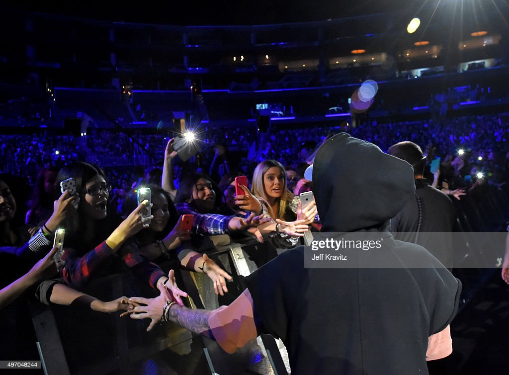Singer/songwriter Justin Bieber interacts with fans during an evening with Justin Bieber to celebrate the release of his new album 'Purpose' at Staples Center on November 13, 2015 in Los Angeles, California.