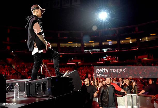 Singer/songwriter Justin Bieber performs onstage during an evening with Justin Bieber to celebrate the release of his new album 'Purpose' at Staples...
