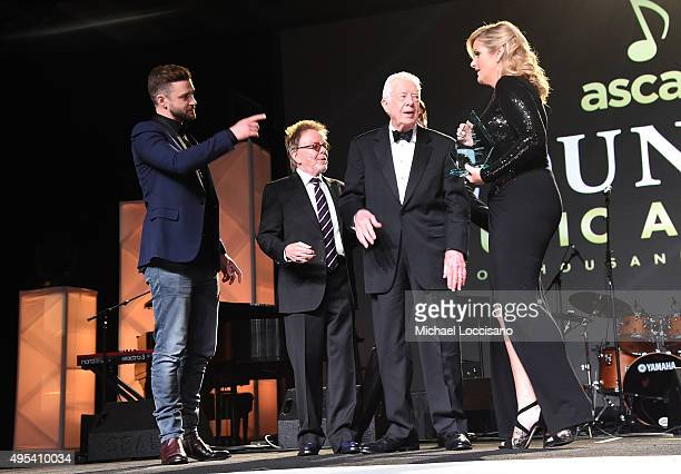 Singersongwriter Justin Timberlake ASCAP President and Chairman of the Board Paul Williams President Jimmy Carter and singer Trisha Yearwood attend...