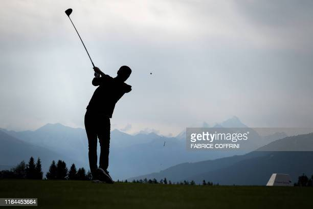 TOPSHOT US singersongwriter Justin Timberlake plays a shot during a proam tournament ahead of the PGA European Tour golf tournament Omega European...