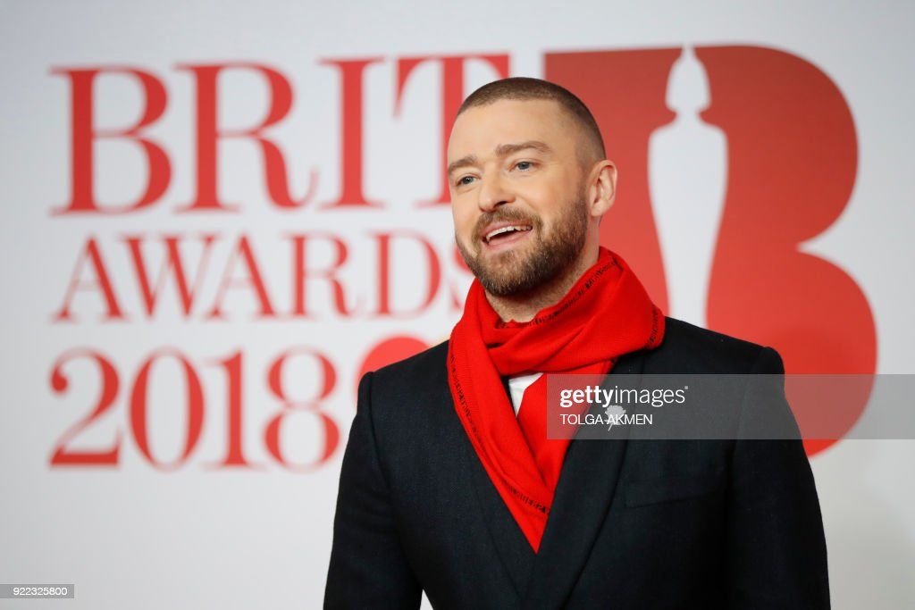 US singer-songwriter Justin Timberlake poses on the red carpet on arrival for the BRIT Awards 2018 in London on February 21, 2018. / AFP PHOTO / Tolga AKMEN / RESTRICTED