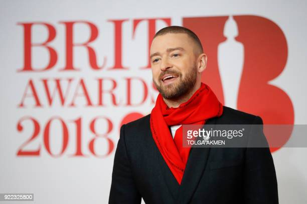 US singersongwriter Justin Timberlake poses on the red carpet on arrival for the BRIT Awards 2018 in London on February 21 2018 / AFP PHOTO / Tolga...