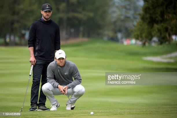 Singer-songwriter Justin Timberlake stands behind Northern Ireland golf player Rory McIlroy during a pro-am tournament ahead of the PGA European Tour...