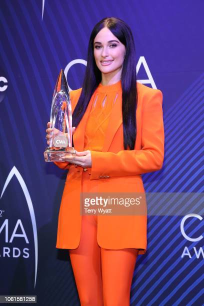 Singersongwriter Kacey Musgraves poses with an award at the 52nd annual CMA Awards at the Bridgestone Arena on November 14 2018 in Nashville Tennessee