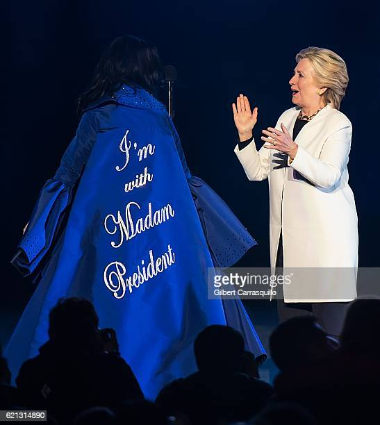 Singersongwriter Katy Perry and Democratic presidential nominee former Secretary of State Hillary Rodham Clinton on stage during Katy Perry holds Get...