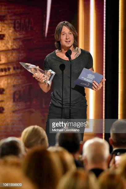 Singersongwriter Keith Urban accepts award onstage during the 52nd annual CMA Awards at the Bridgestone Arena on November 14 2018 in Nashville...