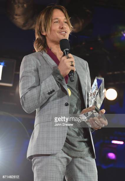 Singersongwriter Keith Urban accepts the BMI Champion Award onstage during the 65th Annual BMI Country Awards at BMI on November 7 2017 in Nashville...