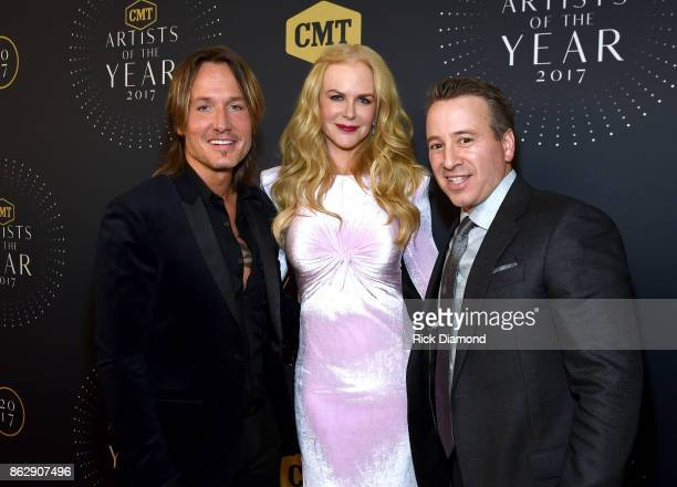 Singersongwriter Keith Urban actress Nicole Kidman and General Manager CMT and TV Land Frank Tanki arrives at the 2017 CMT Artists Of The Year on...