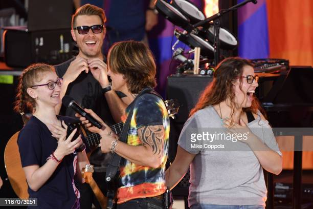 "Singer/songwriter Keith Urban brings fans on stage as he performs on ABC's ""Good Morning America"" at SummerStage at Rumsey Playfield, Central Park on..."
