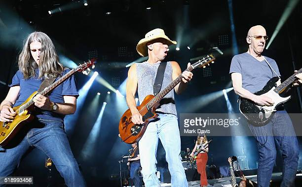Singersongwriter Kenny Chesney and guitarist Kenny Greenberg perform onstage during the 4th ACM Party For A Cause Festival at the Las Vegas Festival...