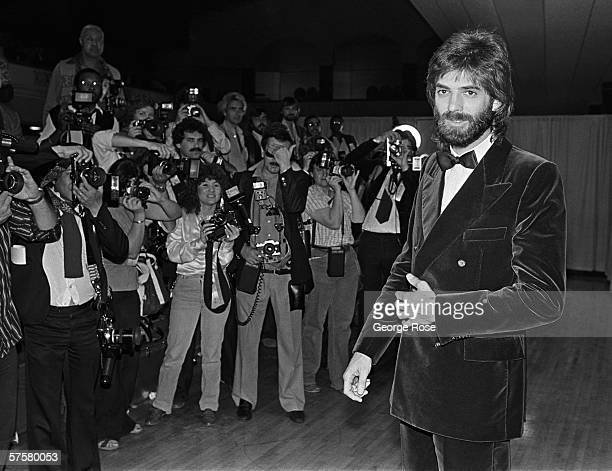 Singer/songwriter Kenny Loggins poses for photographers backstage at the 1980 Grammy Awards in Los Angeles California