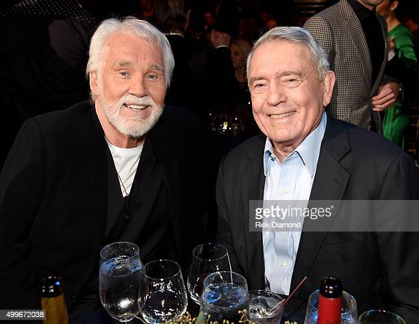 Singersongwriter Kenny Rogers and news anchor Dan Rather attend the 2015 CMT Artists of the Year at Schermerhorn Symphony Center on December 2 2015...