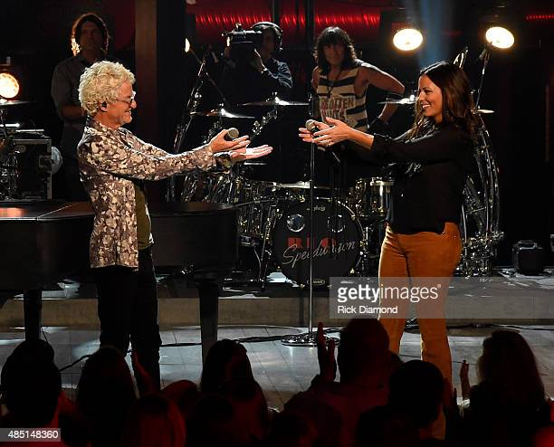 Singer/Songwriter Kevin Cronin of REO Speedwagon and singer/songwriter Sara Evans perform on stage during the CMT Crossroads taping of REO Speedwagon...