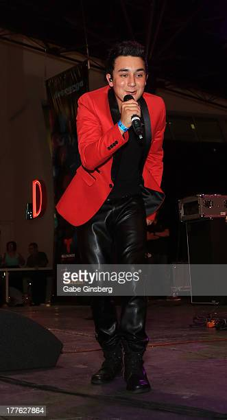 Singer/songwriter Kevin Ortiz performs at Telemundo and mun2's final 2013 Descarga concert at the Fremont Street Experience on August 24 2013 in Las...