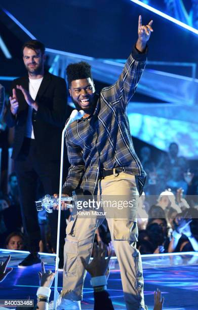 Singer/songwriter Khalid accepts award onsstage during the 2017 MTV Video Music Awards at The Forum on August 27, 2017 in Inglewood, California.
