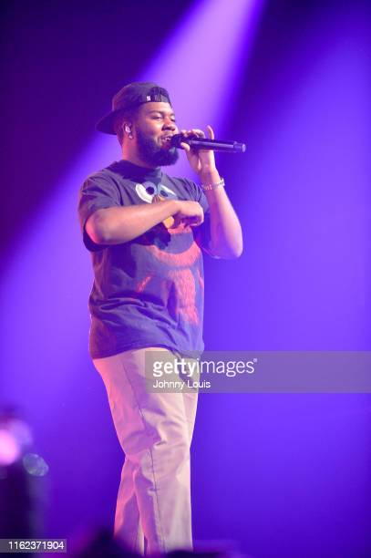 Singer-songwriter Khalid performs during 'Khalid Free Spirit World Tour' at AmericanAirlines Arena on August 17, 2019 in Miami, Florida.