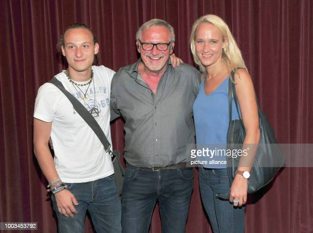 Singersongwriter Konstantin Wecker his wife Annik and his son Tamino laugh during a break of his birthday concert at Circus Krone in Munich Germany...