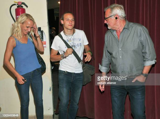 Singersongwriter Konstantin Wecker his wife Annik and his son Tamino talk to each other during a break of his birthday concert at Circus Krone in...